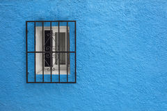 Mediterranean window and rough blue wall. Detail of mediterranean window and rough blue wall Stock Photography
