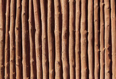 Mediterranean wooden trunks wall texture. In Majorca Stock Images