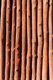 Mediterranean wooden trunks wall texture. In Majorca Stock Photo
