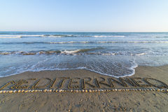 Mediterranean. Word Mediterranean written on the seashore Stock Images