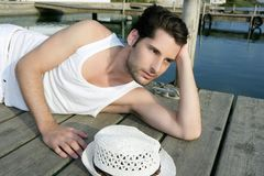 Mediterranean young man relaxed on wood pier Royalty Free Stock Images