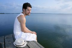 Mediterranean young man relaxed on wood pier Stock Image
