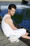 Mediterranean young man relaxed on wood pier Royalty Free Stock Image