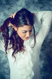 Mediterranean young woman with long brown hair with long brown hair Royalty Free Stock Photo