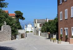 Mediterranian street view with the tiny church and mountains Royalty Free Stock Photo
