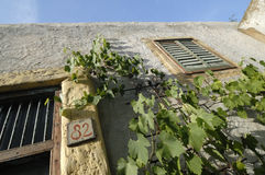 Mediterrean House in Greece. Typical greek house decorated with vineyards stock image