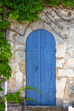 Mediterrenean narrow wooden door Royalty Free Stock Photo