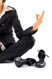 Meditierende Geschäftsfrau Stockbilder