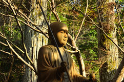 Meditierender Buddha im Holz, Kyoto Japan Lizenzfreie Stockfotografie