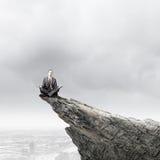 Meditierender Geschäftsmann Stockfoto
