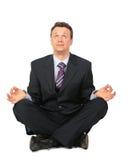Meditierender Geschäftsmann Stockfotografie