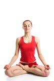 Meditierendes Mädchen in der Yogahaltung Stockfotografie