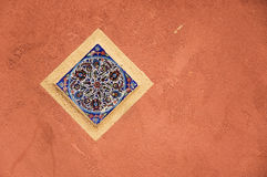 Meditterenean wall. Meditterenean plaster wall and ceramic ornament Stock Photos