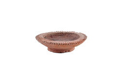 Medium Ancient Lanna style Candle holder. This Ancient Lanna style Candle holder is made from handmade of clay pottery in the north of Thailand Royalty Free Stock Photography