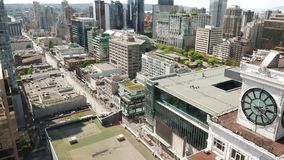 Medium angle aerial of downtown Vancouver. Video taking from business building window stock footage