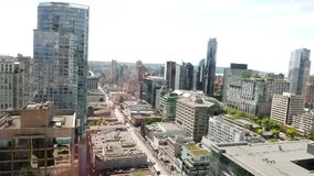 Medium angle aerial of downtown vancouver. Video taking from business building window stock video