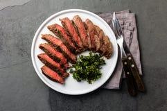 Medium beef steak on white plate, slate background Stock Photography