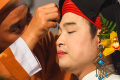 Medium being dressed up for spirit mediumship ritual in Vietnam Stock Image