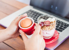 Medium boiled egg breakfast with granola on work station Stock Images