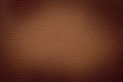 Medium Brown Neutral Snake Skin Texture. Medium brown colored texture of a snake skin imitation usefull as a fashion style background or gift card Royalty Free Stock Image
