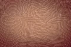Medium Brown Neutral Snake Skin Texture. Medium brown colored texture of a snake skin imitation usefull as a fashion style background or gift card Royalty Free Stock Photo