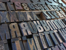 Medium Close up Large Metal Block Type Letters. Medium Close up of large metal moveable type block letters, used in printing presses prior to the digital age Royalty Free Stock Images
