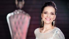 Medium close-up portrait of pretty stylish luxury girl smiling posing at vintage background stock footage