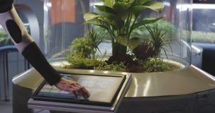 Scientist controlling plant incubator