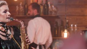 Medium close up shot of a female saxophonist performing a song stock footage