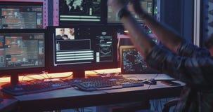 Young hacker celebrating success. Medium close-up of a young hacker celebrating success stock video footage