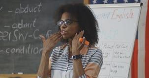 Young teacher explaining to a class stock photos