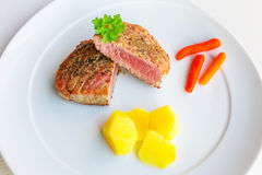 Medium cooked tuna steak Royalty Free Stock Photo