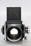 Medium format camera with lens frontview. Picture of a medium format camera frontview Royalty Free Stock Photo