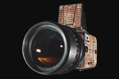 Medium format photo camera isolated on black. Medium format professional photo camera with lens isolated on black Stock Photo