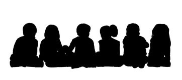 Medium group of children seated silhouette 1. Black silhouettes of medium group of children about age 5-10 seated in a row on the floor face to the onlooker in Stock Photo