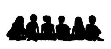 Medium group of children seated silhouette 2. Black silhouettes of medium group of children about age 5-10 seated in a row on the floor face to the onlooker in Royalty Free Stock Photos