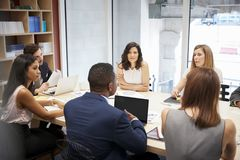 Medium group of people at a boardroom meeting stock image