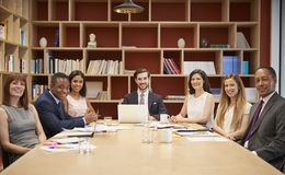 Medium group of people at a business boardroom meeting royalty free stock photo