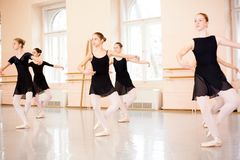 Medium group of teenage girls practicing classical ballet stock photography