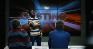 Young man`s casting. Medium long shot of young man`s casting in front of jury stock footage