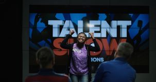 Young woman rejoices during talent tv show stock photo