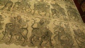 Wall Mural Paintings | Khoo Kongsi, Penang. Medium low-angle panning shot of an ancient wall mural with paintings of celestial guardians Georgetown, Penang stock video footage