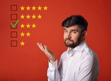The medium, not very best rating, evaluation, online review. Tree stars. The time to make better your business. Happy doubt beard. Ed business gesturing the hand stock photo