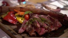 Medium rare beef steak on wood plate eating