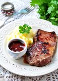 Medium rare grilled Beef steak with mashed potatoes and barbecue sauce Stock Photography