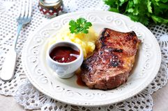 Medium rare grilled Beef steak with mashed potatoes and barbecue sauce Stock Images