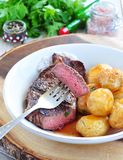 Medium rare grilled Beef steak with roasted potato Stock Image