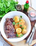 Medium rare grilled Beef steak with roasted potato Stock Images