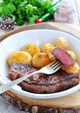 Medium rare grilled Beef steak with roasted potato Royalty Free Stock Photo