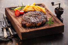 Medium rare grilled Steak Ribeye with french fries Stock Photography